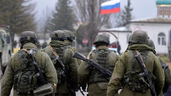 Russian soldiers patrol the area surrounding the Ukrainian military unit in Perevalnoye, outside Simferopol, on March 20, 2014. Kiev will never recognise Russia's annexation of Crimea and will fight for the 'liberation' of the strategic Black Sea peninsula, Ukraine's parliament said in a resolution adopted on March 20