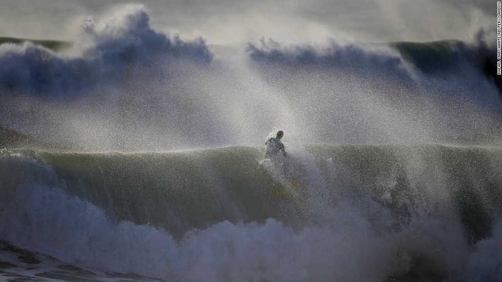 A bodyboarder rides a wave during Sumol Nazare Special Edition competition in Nazare, Portugal, on Wednesday, March 19. The event started 10 years ago and gathers bodyboarders from different countries.
