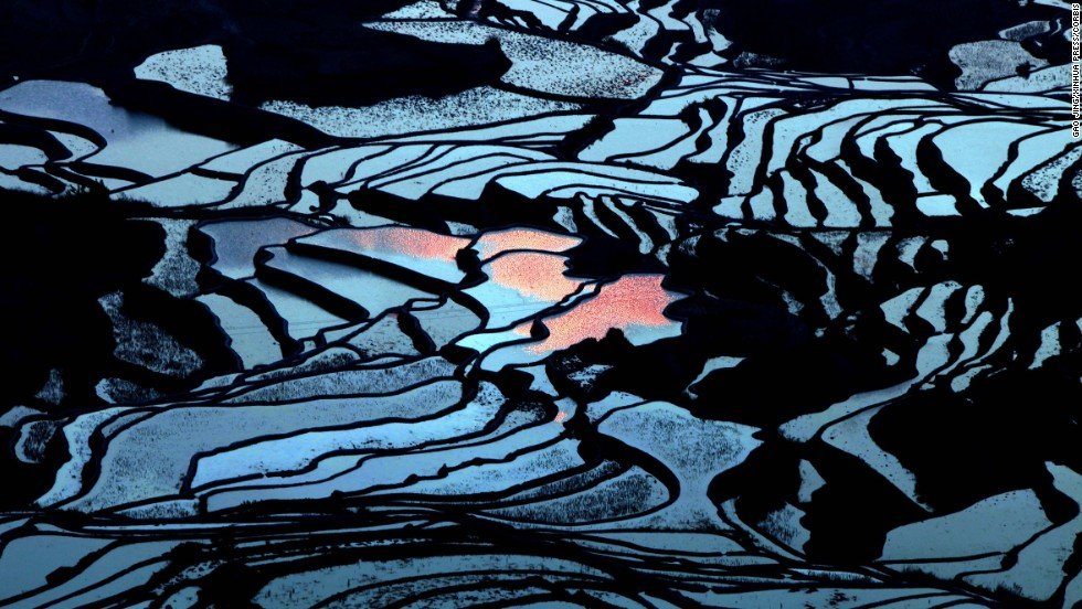 "The terraced fields of southwest China's Yunnan province are seen on Wednesday, March 19. UNESCO's World Heritage Committee added the <a href=""http://whc.unesco.org/en/list/1111"" target=""_blank"">Cultural Landscape of Honghe Hani Rice Terraces</a> to the prestigious World Heritage List last year."