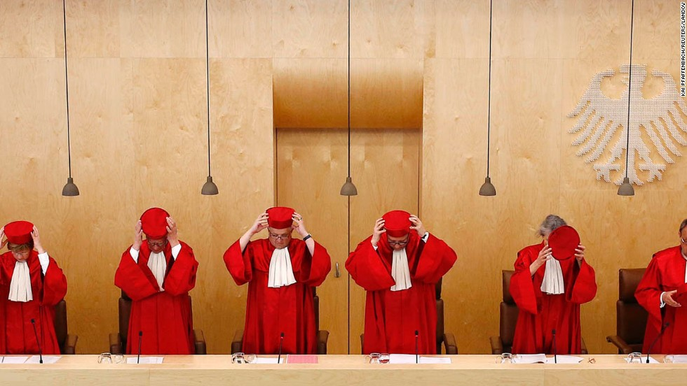 The Second Senate of Germany's Federal Constitutional Court takes off their hats prior to a verdict in Karlsruhe on Tuesday, March 18.