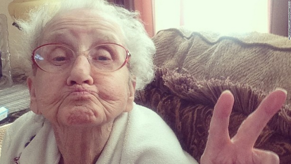 "Grandma Betty flashes a peace sign while sporting ""duck face."""