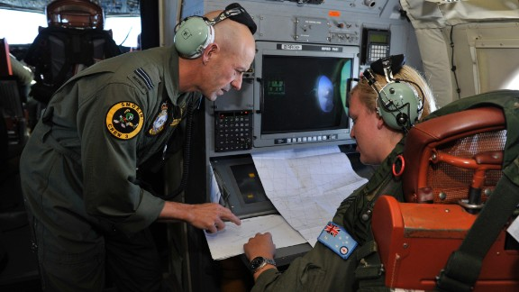 Royal Australian Air Force personnel discuss the search area aboard the Royal Australian Airforce AP-3C Orion, some 2,500 km southwest of Perth over the Indian Ocean on March 21.