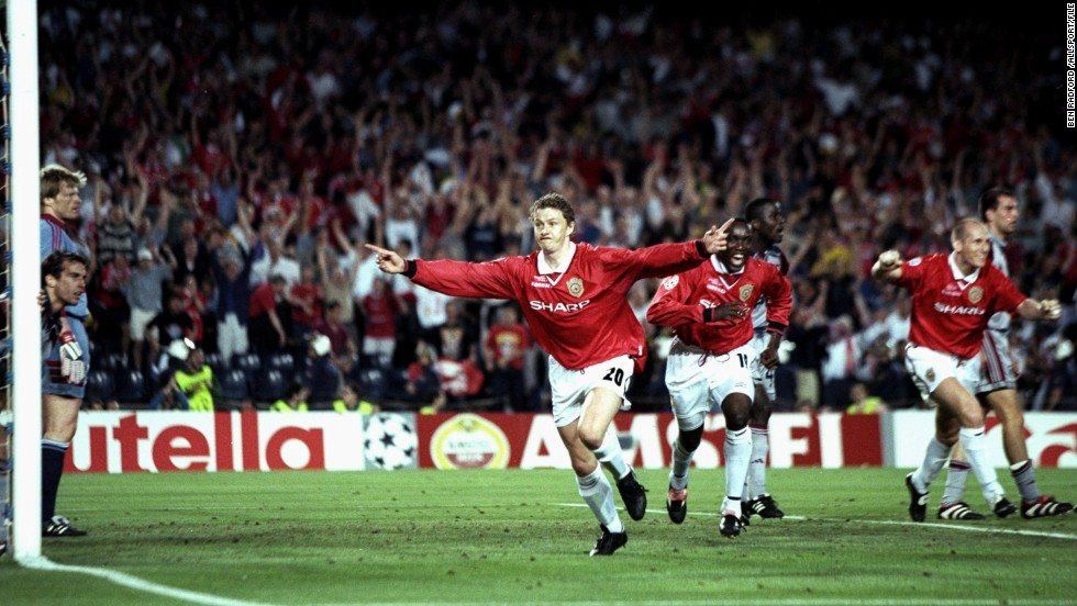 Ole Gunnar Solskjaer celebrates after scoring a dramatic 93rd-minute winner for Manchester United, who had been trailing to Bayern Munich for much of the game. Teddy Sheringham notched the equalizer just minutes before Solskjaer's effort.