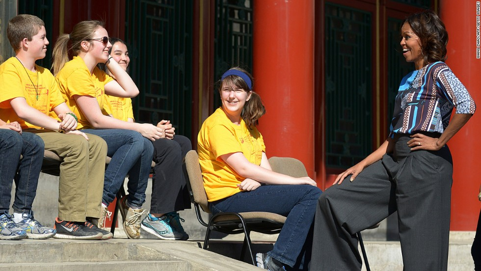 Obama talks to a group of students from Chicago as she visits the Summer Palace in Beijing on March 22.