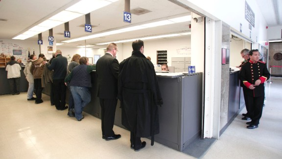 Same-sex couples get their marriage licenses at the Oakland County Courthouse in Pontiac, Michigan, on March 22, 2014, a day after a federal judge overturned Michigan