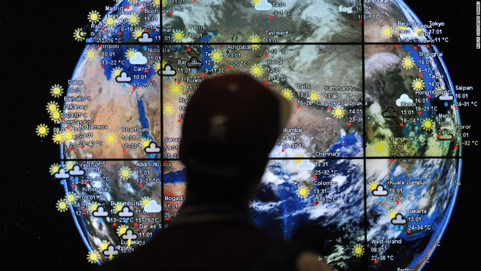 A passenger views a weather map in the departures terminal of Kuala Lumpur International Airport on March 22, 2014.