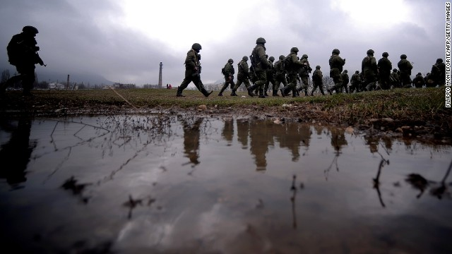 Russian soldiers patrol the area surrounding the Ukrainian military unit in Perevalnoye, outside Simferopol, on March 20, 2014.