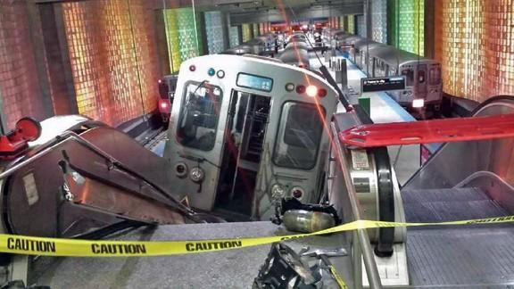 A commuter train car lies halfway up an escalator at Chicago
