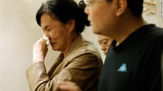 A family member of a passenger from the missing Malaysia Airlines flight MH370 shows her emotion at Lido Hotel on March 24, 2014 in Beijing, China