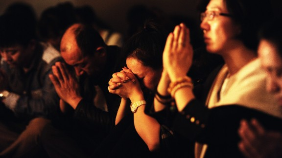 Image #: 28283032    epa04138872 Relatives hold a candlelight vigilance for the passengers on the missing Malaysia Airlines airliner MH370 in Beijing, China, 24 March 2014. The search is being conducted in an area 2,500km off the South West coast of Perth after the Malaysian Airways aircraft went missing on 08 March whilst on a flight between Kuala Lumpur and Beijing. An Australian surveillance aircraft on 24 March spotted two objects in the southern Indian Ocean that could be related to the missing Malaysian jet, raising hope of locating the aircraft after more than two weeks of search. Ten aircrafts in total are scouring a 59,000-square-kilometre patch of sea between Australia and Antarctica for a clue that could lead to the location of the missing plane.  Malaysia Airlines' Boeing 777-200 disappeared on 08 March 2014 from radar as it flew from Kuala Lumpur to Beijing.  EPA/MARK WONG/EPA/LANDOV