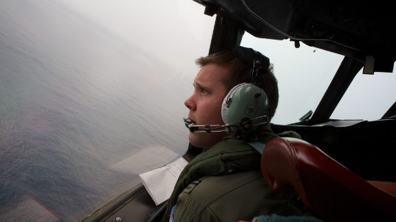 Image #: 28282552    epa04138821 Co-Pilot, Flying Officer Marc Smith turns his RAAF AP-3C Orion aircraft at low level in bad weather whilst searching for missing Malaysia Airways Flight MH370 at sea off Australia, 24 March 2014. The search is being conducted in an area 2,500km off the South West coast of Perth after the Malaysian Airways aircraft went missing on 08 March whilst on a flight between Kuala Lumpur and Beijing. An Australian surveillance aircraft on 24 March spotted two objects in the southern Indian Ocean that could be related to the missing Malaysian jet, raising hope of locating the aircraft after more than two weeks of search. Ten aircraft in total are scouring a 59,000-square-kilometre patch of sea between Australia and Antarctica for a clue that could lead to the location of the missing plane.  RICHARD WAINWRIGHT/EPA/LANDOV