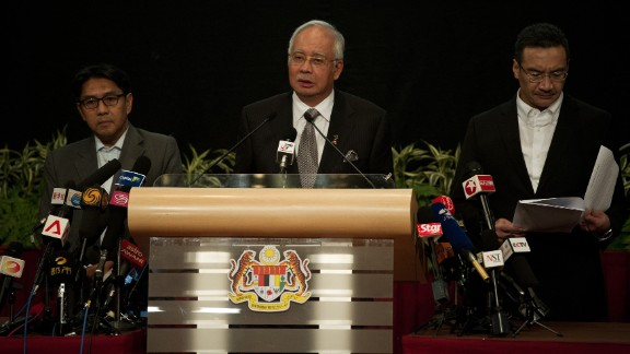 Malaysian Prime Minister Najib Razak, center, delivers a statement about the flight on March 24, 2014. Razak