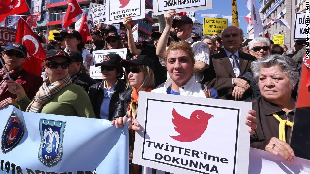 "Protesters hold placards reading ""Do not touch my Twitter"" during a protest against the Turkish government's Twitter ban."