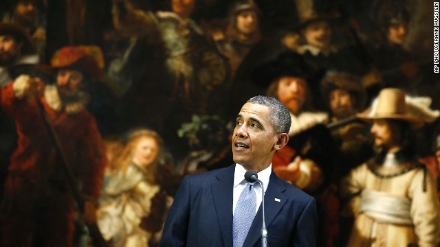 U.S. President Barack Obama delivers a statement in front of Dutch master Rembrandt's The Night Watch painting during a visit to the Rijksmuseum in Amsterdam, Netherlands, Monday, March 24, 2014. Obama will attend the two-day Nuclear Security Summit in The Hague. (AP Photo/Frank Augstein)