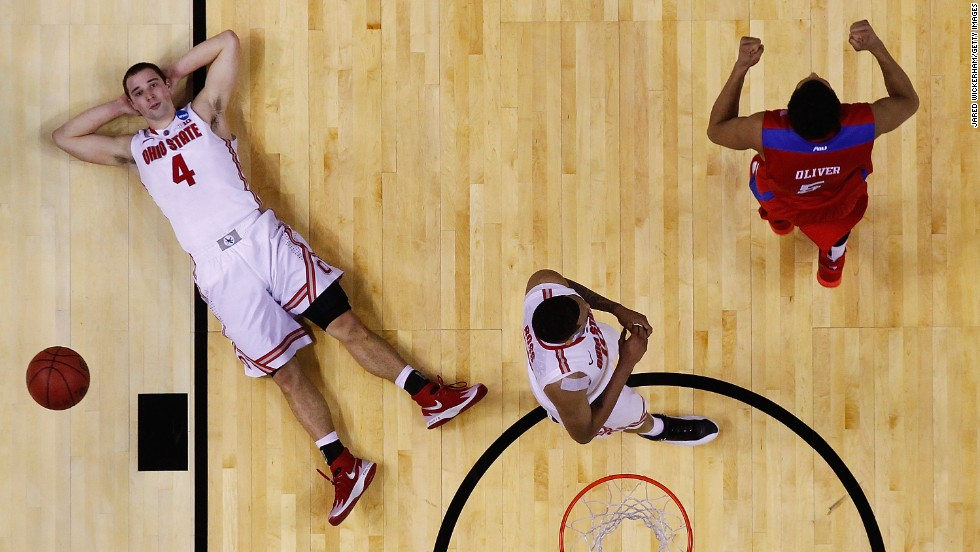 Ohio State point guard Aaron Craft, left, lies on the court after missing a shot to beat Dayton during their NCAA Tournament game on Thursday, March 20.