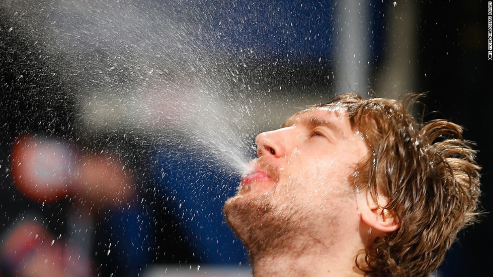 Sergei Bobrovsky, goalie for the NHL's Columbus Blue Jackets, takes a water break during a game against the New York Islanders on Sunday, March 23, in Uniondale, New York.