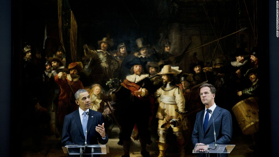 "Obama and Dutch Prime Minister Mark Rutte hold a news conference in front of Rembrandt's ""The Night Watch"" following meetings at the Rijksmuseum on March 24."