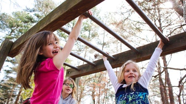 Students swing from the monkey bars at Hess Academy in Decatur, Georgia. The private school gives kids opportunities to stay active throughout the day.