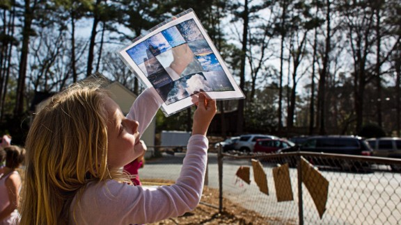 A student uses a template to identify different types of clouds. Students use the playground during free time, but also during classroom learning activities.
