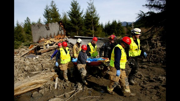 A search-and-rescue team carries the body of a victim on March 24.