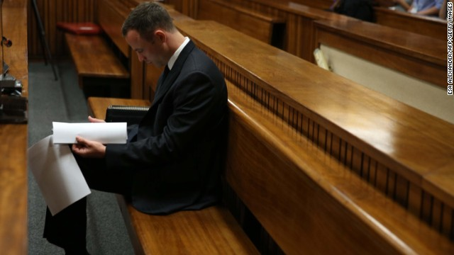 "Paralympic track star Oscar Pistorius sits in the dock ahead of his trial for the murder of his girlfriend Reeva Steenkamp, at the North Gauteng High Court in Pretoria, on March 25, 2014. Oscar Pistorius's girlfriend Reeva Steenkamp told the athlete she was sometimes scared of him in a text message sent less than three weeks before he shot her dead, his murder trial heard Thursday. ""I'm scared of you sometimes and how you snap at me and how you react to me,"" Steenkamp said via messaging service WhatsApp after the athlete apparently created a scene thinking that she had flirted with another man. AFP PHOTO / POOL - Esa Alexander        (Photo credit should read Esa Alexander/AFP/Getty Images)"