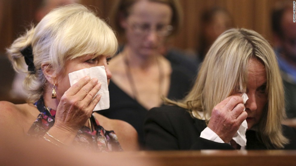 Steenkamp's mother, right, and family friend Jenny Strydom react in court Tuesday, March 25, during cross-questioning.