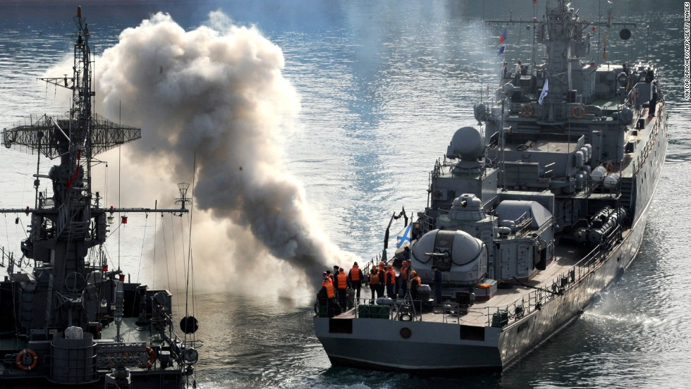 Russian sailors stand on the deck of the corvette ship Suzdalets in the bay of Sevastopol on March 25.