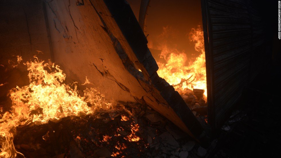 The fire rages through the Guatemalan market.