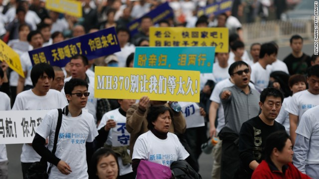 Chinese relatives of flight MH370 walk towards the Malaysian Embassy on March 25, 2014 in Beijing, China. Hundreds of protesters, including many relatives of missing flight MH370 passengers, marched on the Malaysian Embassy in Beijing demanding answers from Malaysian authorities about the fate of the flight.