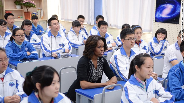 US First Lady Michelle Obama (C) sits in class with students at the Chengdu No7 High School in Chengdu in China's southwest Sichuan province on March 25, 2014. Michelle Obama arrived in China on March 20 with her mother and daughters to kick off a seven-day, three-city tour where she will focus on education and cultural exchange. AFP PHOTO/Peter PARKS (Photo credit should read PETER PARKS/AFP/Getty Images)