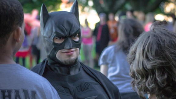 """Austin, Texas resident Eli Vizcaino, seen here dressed as Batman, credits the character with helping him """"find his voice."""" Vizcaino had a speech impediment as a child, and when he read Batman stories aloud as therapy, they freed his imagination."""