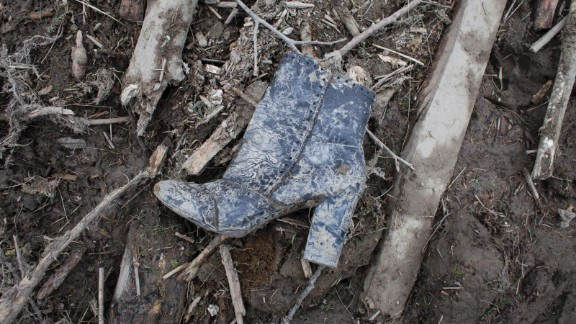 A boot is found among the debris on March 25.