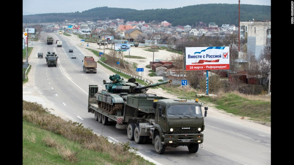 Ukrainian tanks are transported from their base in Perevalne, Crimea, on Wednesday, March 26. After Russian troops seized most of Ukraine's bases in Crimea, interim Ukrainian President Oleksandr Turchynov ordered the withdrawal of armed forces from the Black Sea peninsula, citing Russian threats to the lives of military staff and their families.