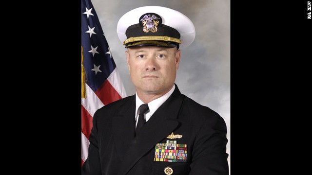 U.S. Navy Commander John Regelbrugge died in the Washington state landslide, along with his wife, Kris, according to family members.