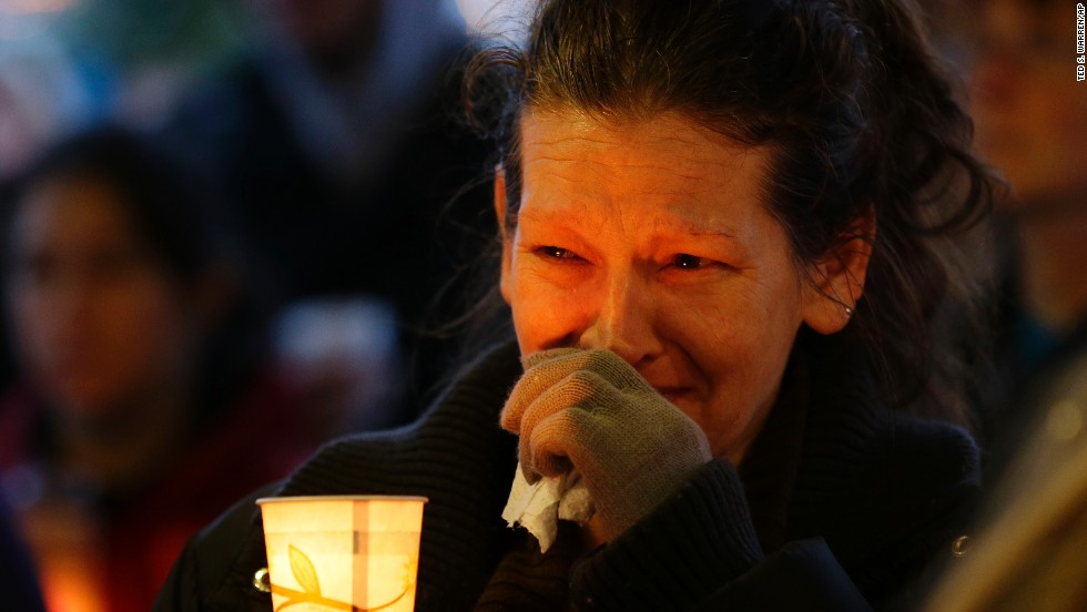 Teresa Welter cries during a candlelight vigil in Arlington on Tuesday, March 25.