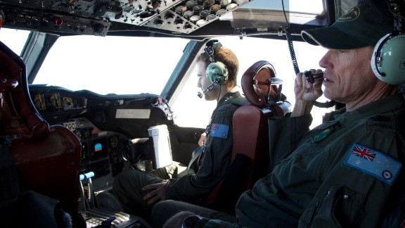 Flying Officer Stuart Doubleday, left, and Warrant Officer Michael Makin are in the cockpit of a Royal Australian Air Force AP-3C Orion aircraft during a search operation of the missing Malaysian Airlines flight MH370 over the southern Indian Ocean, Thursday, March 27, 2014. Planes and ships searching for debris suspected of being from the downed Malaysia Airlines jetliner failed to find any Thursday before bad weather cut their hunt short in a setback that came as Thailand said its satellite had spotted even more suspect objects. (AP Photo/Michael Martina, Pool)