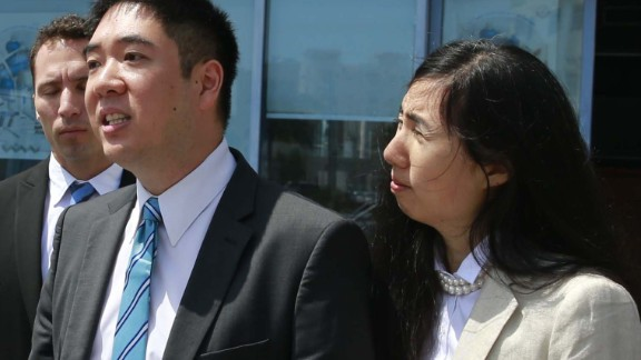 Matthew and Grace Huang speak to reporters outside the entrance of the Court of First Instance before their trial in Doha, March 27, 2014.