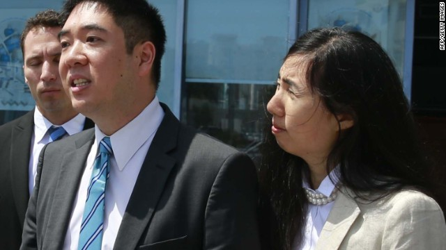 Matthew and Grace Huang speak to the press outside the Court of First Instance before their trial in Doha, Qatar on March 27.