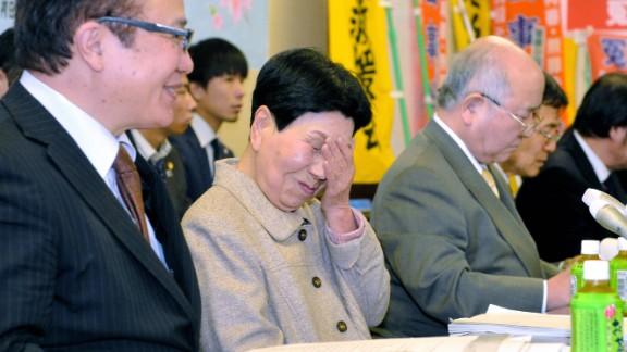 Hideko Hakamada, center, sheds tears of joy after the court ruling.