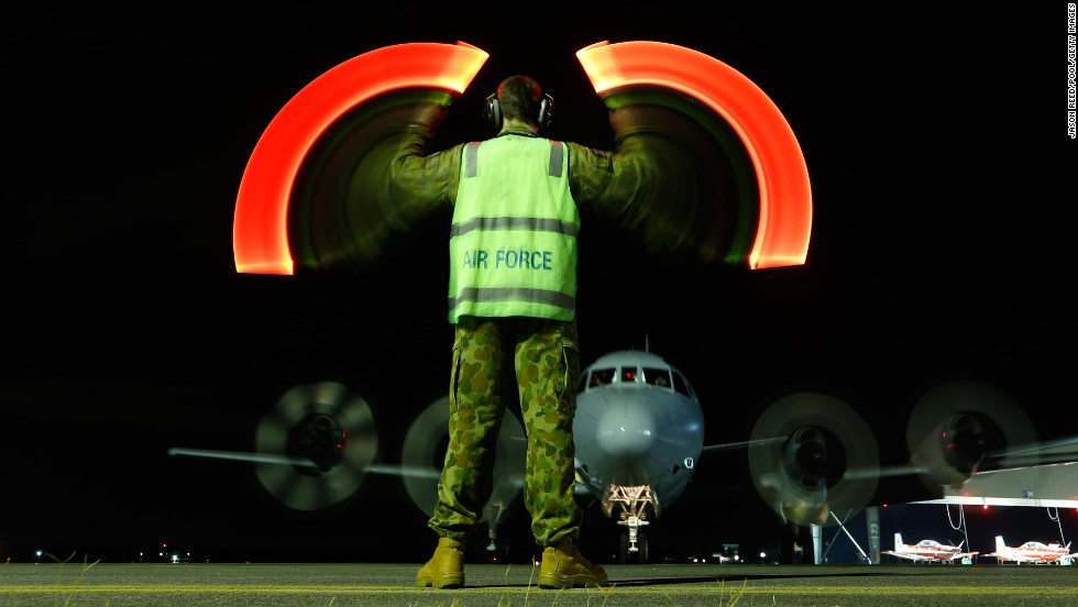 "A plane with the Royal Australian Air Force returns to base in Bullsbrook, Australia, on Wednesday, March 26, after being used in <a href=""http://www.cnn.com/2014/03/07/asia/gallery/malaysia-airliner/index.html"">the search for Malaysia Airlines Flight 370</a>. A slow shutter speed was used to create the light effect in this photo."