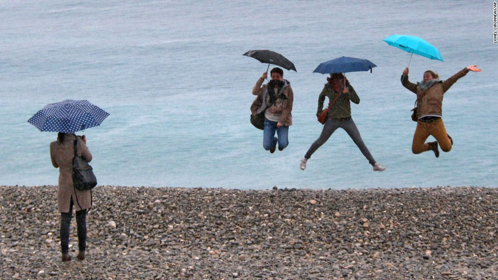 Tourists in Nice, France, jump for a photo in front of the Mediterranean Sea on Saturday, March 22.
