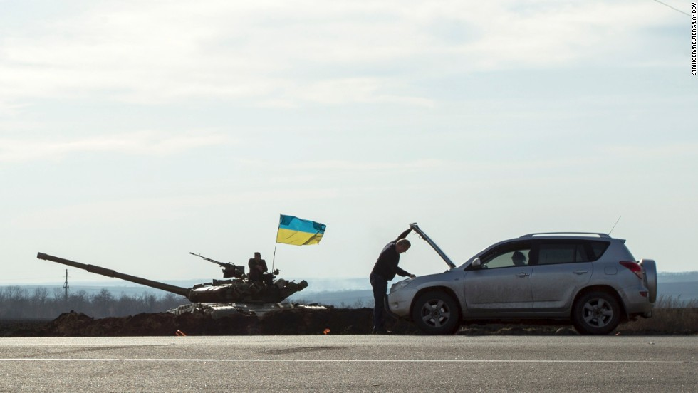 "A motorist checks his car next to a tank Monday, March 24, in Kharkiv, Ukraine, close to the Russian border. There have been <a href=""http://www.cnn.com/2014/03/26/world/gallery/ukraine-crisis/index.html"">heightened tensions in the country</a> since Russia annexed the region of Crimea earlier this month."
