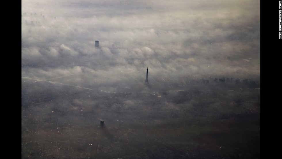 The Eiffel Tower peeks above the morning fog in 2005.