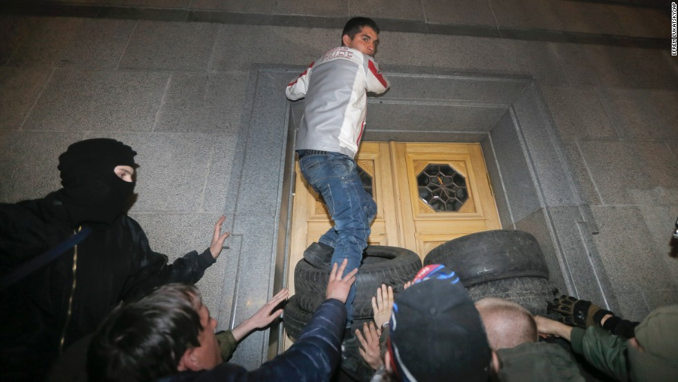 "Members of the Right Sector group block the Ukrainian parliament building in Kiev on Thursday, March 27. Activists called for Interior Minister Arsen Avakov to step down after the <a href=""http://www.cnn.com/2014/03/26/world/europe/ukraine-right-wing/index.html"">recent killing of radical nationalist leader Oleksandr Muzychko</a>, who died during a police operation to detain him. Muzychko and the Right Sector are credited with playing a lead role in the protests that toppled Ukrainian President Victor Yanukovych."