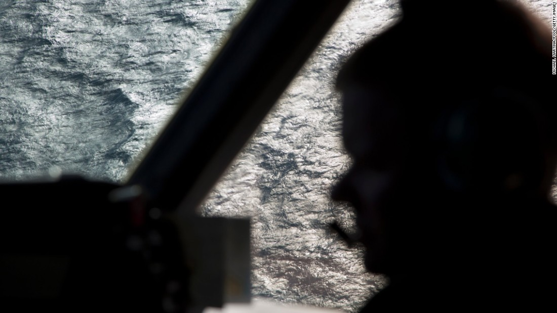 A member of the Royal Australian Air Force is silhouetted against the southern Indian Ocean during the search for the missing jet on March 27, 2014.