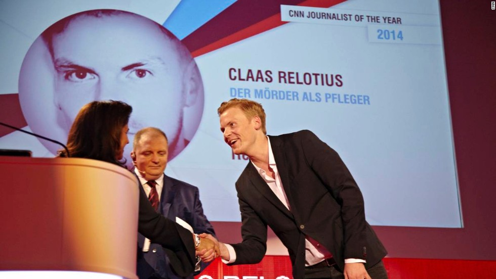 Claas Relotius is awarded the CNN Journalist of the Year 2014 accolade by Parisa Khosravi, senior vice president for CNN Worldwide.