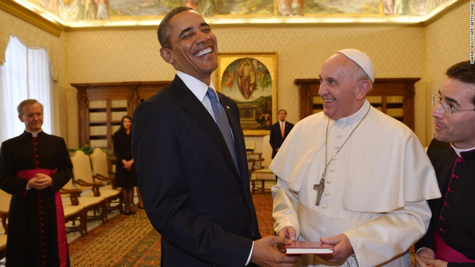 President Barack Obama and Pope Francis exchange gifts during a private audience on March 27, 2014 at the Vatican.