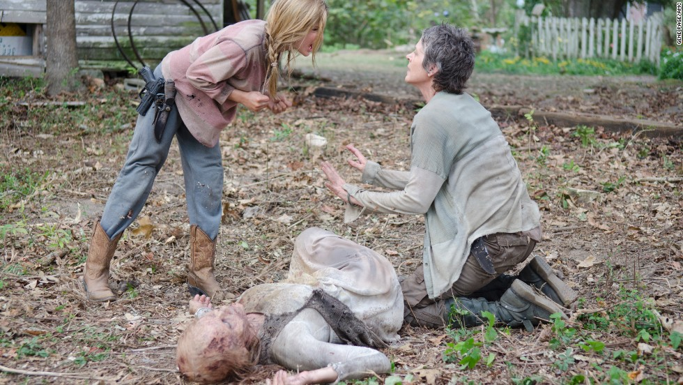 "Among the most shocking deaths in the fourth season was that of young Lizzie (Brighton Sharbino, left), who died at the hands of Carol (Melissa McBride, right) after killing her younger sister, Mika. Lizzie's sense of right and wrong and life and death had been warped by the zombie apocalypse. Just as she did earlier in the season, Carol had to make the decision that someone was too dangerous to live. Carol urged Lizzie to follow her therapy of ""look at the flowers"" before she shot her in the back of the head."