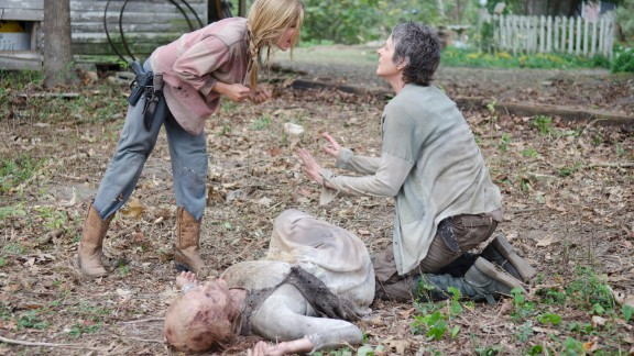 Among the most shocking deaths in the fourth season was that of young Lizzie (Brighton Sharbino, left), who died at the hands of Carol (Melissa McBride, right) after killing her younger sister, Mika. Lizzie
