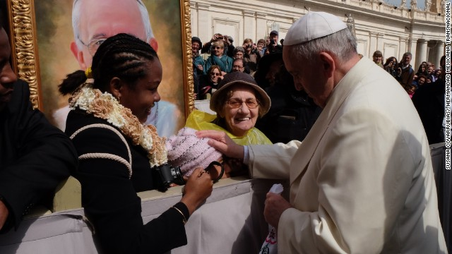 Pope Francis pats Jersey Vargas on the head and blesses her during her trip to the Vatican in March 2014.
